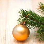 Orange ball on the Christmas tree — Stock Photo