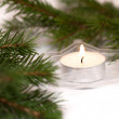 Christmas composition with candle and fir branches — Stock Photo