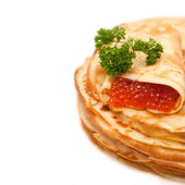 Pancakes with red caviar - traditional russian food — Stock Photo