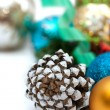 Christmas composition with pine cones and balls on a white background — Stock Photo