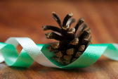 Fir cone and ribbon for christmas — Stock Photo