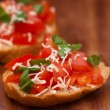 Stock Photo: Bruschettwith grilled ciabatta, olive oil, chopped tomato, garlic and parsley leaves on wooden board