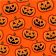 Halloween Pumpkins vector pattern in orange background — Stock Vector