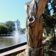 Stock Photo: Inlaid tree against city pond.