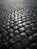 Cobblestone road in backlight — Stock Photo
