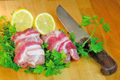Chicken rolls with bacon and knife — Stock Photo