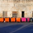 Row of colored rubbish bins — Stock Photo #19269667