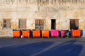 Row of colored rubbish bins — Stock Photo