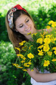 Freshly cut flowers in woman's hand — Stock Photo
