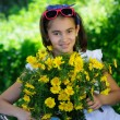 Cute child with daisies — Stock Photo
