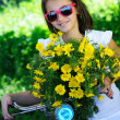 Cute child with daisies and bike — Stock Photo