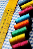 Tailor's measuring tape and spools — Stock Photo