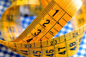 Tailor's measuring tape on fabric — 图库照片
