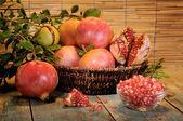 Pomegranates on wooden board — Stock Photo