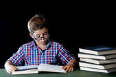 Young student reading a book — Stock Photo