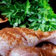 Stock Photo: Chicken leg seasoned with paprikand parsley
