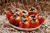 Basket full of persimmons — Stock Photo