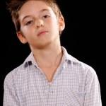 Portrait of a serious boy — Stock Photo #34047471