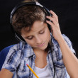 Stock Photo: Young student listening music