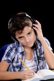Little boy listening and writing — Stock Photo