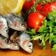 Fresh sardines on Chopping Board — Stock Photo
