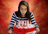 Girl with a beautiful cake for the new year — Stock Photo