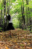 Pretty woman in a forest — Stock Photo