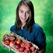 Little girl and apples — Stock Photo