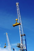 Container cranes against blue sky — Stock Photo