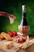 Red wine ham and cheese — Stock Photo
