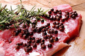 Sirloin steak pink pepper and rosemary — Stock Photo
