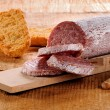 Stock Photo: Seasoned salami and grissini