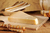 Parmesan cheese with bread sticks — Stock Photo