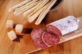 Italian grissini cheese and salame — Stock Photo
