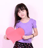 Girl and heart shape paper — Stock Photo