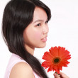 Lady with gerbera flower — Stock Photo