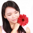 Lady with gerbera flower — Stockfoto