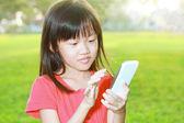 Child with smartphone — Stock Photo