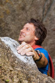 Climber during climbing the mountain — Stock Photo