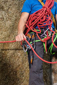 Climber holding red climbing rope — Stock Photo