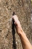 Hand of climber during climbing the mountain — Stock Photo