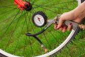 Bicycle and air compressor — Stock Photo
