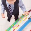 Stock Photo: Suit up small young boy working on the chalkboard