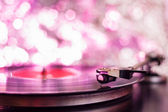 Colorful playing vintage gramophone with blurred blackground — Stock Photo