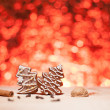 Royalty-Free Stock Photo: Christmas gingerbread with red blurred background