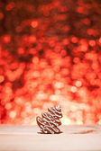 Christmas gingerbread with red blurred background — Stock Photo