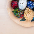 Royalty-Free Stock Photo: Top view of easter eggs in wooden bowl on wooden backgroud
