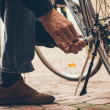 Real reparing of bicycle in the court pavement — Stock Photo