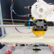 Stock Photo: electronic 3d plastic printer during work in school laboratory