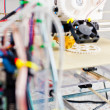 Electronic 3D plastic printer during work in school laboratory — Stock Photo